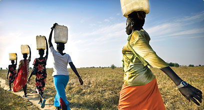 Woman transporting water in Africa.